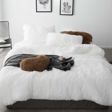 white fluffy bed set
